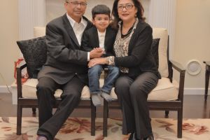 Sumita and her husband with their grandson